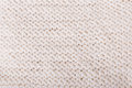 White knitted texture hand knitting purl background closeup Stock Photo