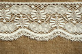 White lace on canvas background with the edge Stock Photo
