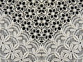 White lace fabric on black background Stock Photo