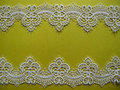 White lace on yellow background Royalty Free Stock Photos