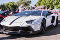 White lamborghini on exhibition parking at an annual event super los angeles california usa abril supercar sunday day abril in Stock Photo