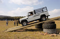 White land rover defender hc on x course bafokeng – may scaling tilt bridge obstacle at new track opening event may at bafokeng Royalty Free Stock Photography