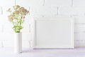 White landscape frame mockup creamy pink flowers in cylinder vase Royalty Free Stock Photo