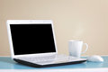 White laptop on table with copy space place for text Royalty Free Stock Photography