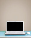 White laptop on table with copy space place for text Royalty Free Stock Photos