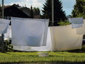 White Laundry Linen Drying in the Sun Backlight Royalty Free Stock Photo