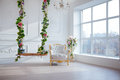 White leather vintage style chair in classical interior room with big window and spring flowers Royalty Free Stock Photo