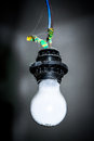 White light bulb hanging in the black cartridge Royalty Free Stock Photo