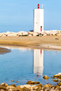 White lighthouse on beach in punta ala tuscany italy Royalty Free Stock Photo