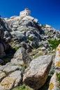 White lighthouse of Capo Testa in north Sardinia Royalty Free Stock Photo