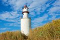White lighthouse in Denmark Stock Image