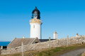 White lighthouse dunnet head at the northern shore of scotland uk Royalty Free Stock Image