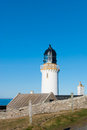 White lighthouse dunnet head at the northern shore of scotland uk Royalty Free Stock Images