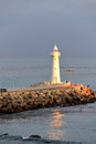 White Lighthouse in the evening sun Royalty Free Stock Photo