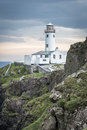 White lighthouse at Fanad Head, Coast of Donegal, Ireland Royalty Free Stock Photo