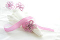 White linen serviette with pink beaded napkin ring Stock Photo