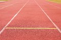 White lines and texture of running racetrack, red rubber racetracks in small stadium Royalty Free Stock Photo