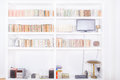 White living room with modern wooden bookshelf Royalty Free Stock Photo