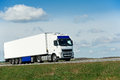 White lorry with white trailer over blue sky Royalty Free Stock Photo