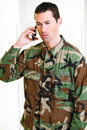 White male in army uniform on cell phone Stock Image