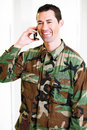 White male in army uniform on cell phone smiling Royalty Free Stock Photo