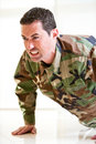 White male in army uniform straining doing a push up Royalty Free Stock Photo