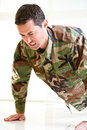 White male in army uniform straining doing a push up Stock Photo