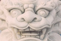 White marble lion statue stand in Chinese temple, Thailand Royalty Free Stock Photo