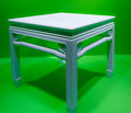 White marble table on a green background Royalty Free Stock Photo
