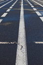 White markings on the pavement piece of Royalty Free Stock Photos
