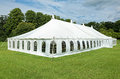 White marquee event tent used as a temporary building for a social Royalty Free Stock Photography