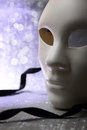 White mask with glittering background Royalty Free Stock Photos