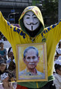 White mask protestor with portrait of king bangkok july a supporter the joins the anti government protestors supporting the Royalty Free Stock Photo