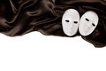 White masks and black silk fabric isolated on Stock Photo