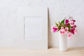 White mat frame mockup with pink and purple flower bouquet Royalty Free Stock Photo