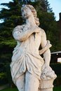 White medieval statue and trees in Castelfranco Veneto, Treviso, Italy Royalty Free Stock Photo