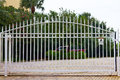 White metal gate and a driveway Royalty Free Stock Photography