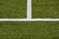 white middle line and sideline on a green turf Royalty Free Stock Photo