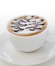 White mocha cup of coffee with paint on foam against Stock Image