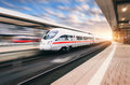White modern high speed train in motion Royalty Free Stock Photo