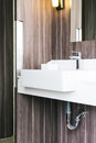 White modern sink and faucet in bathroom