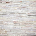 White modern stone brick wall surfaced texture Stock Image