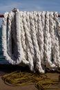 White mooring rope piled on leer vessel Royalty Free Stock Image