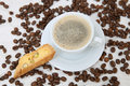 The white mug of american coffee with piece of biscotti Royalty Free Stock Photo