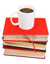 White mug of coffee on stack of books isolated background Stock Image