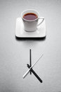 White mug filled tea over minimalistic clock Stock Photo