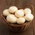 White mushrooms in basket Royalty Free Stock Photo