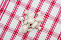 White mushrooms on a red tablecloth Stock Images