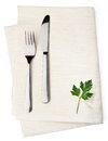 White napkin on background with leaf parsley and cutlery Stock Images