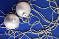 White New Year's toys on bright brilliant jewelry on a blue background Royalty Free Stock Photo